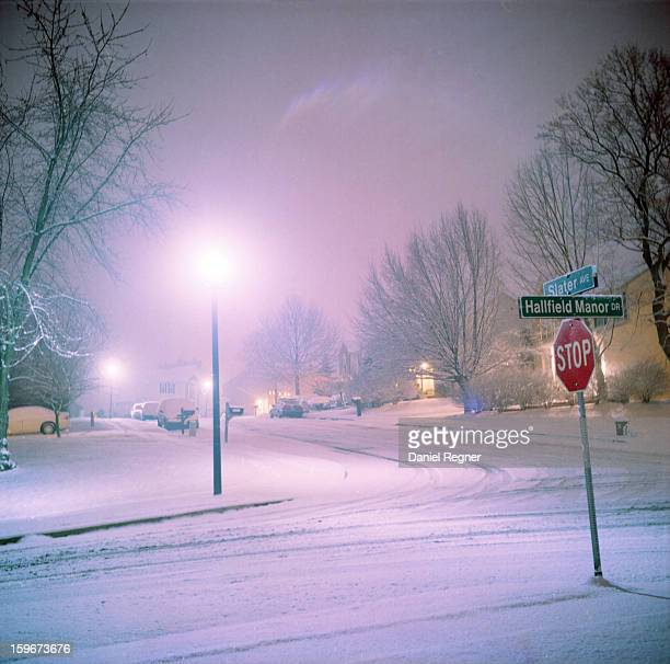 CONTENT] Snowy night in a suburban east coast neighborhood in the United States The roads are somewhat plowed but the snow is sticking to the ground...