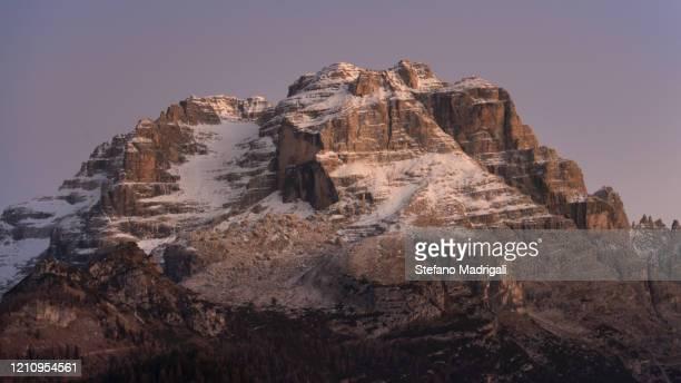 snowy peak of the brenta dolomites in winter at sunset adventure vents unesco - マドンナディカンピリオ ストックフォトと画像