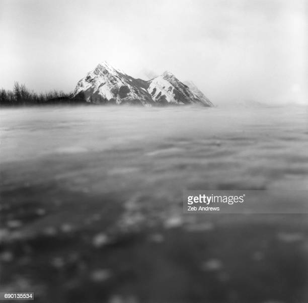 Snowy peak of the Canadian Rockies over frozen Lake Abraham, Alberta, Canada