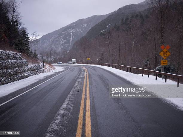 a snowy road in the mountains - sursly stock pictures, royalty-free photos & images