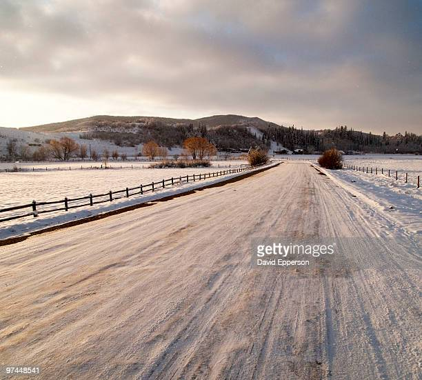 snowy road  - steamboat springs colorado stock photos and pictures
