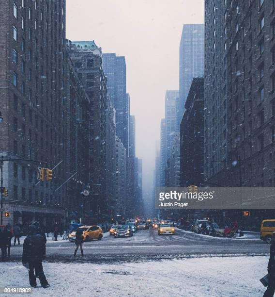 snowy scene in new york - sixth avenue stock pictures, royalty-free photos & images