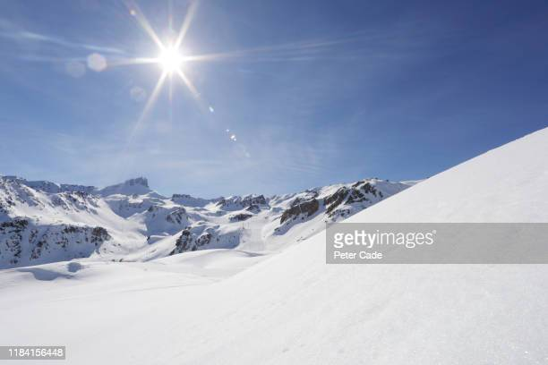 snowy scene in the alps - snowcapped mountain stock pictures, royalty-free photos & images