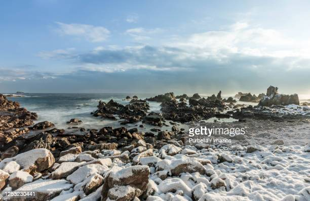 snowy seascape of sinnam beach, samcheok, south korea - gangwon province stock pictures, royalty-free photos & images