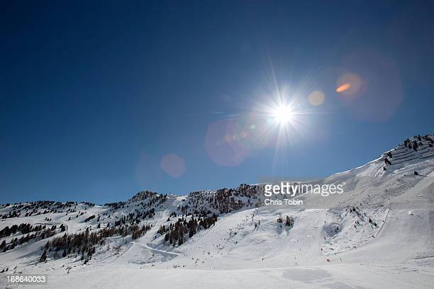 snowy ski resort - blendenfleck stock-fotos und bilder