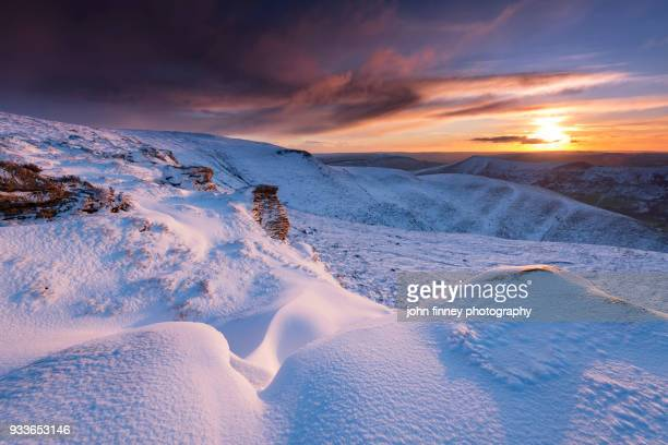 Snowy sunrise from Kinda Scout in the Peak District National Park, UK.