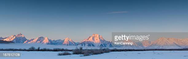 Snowy Teton mountain range at sunset