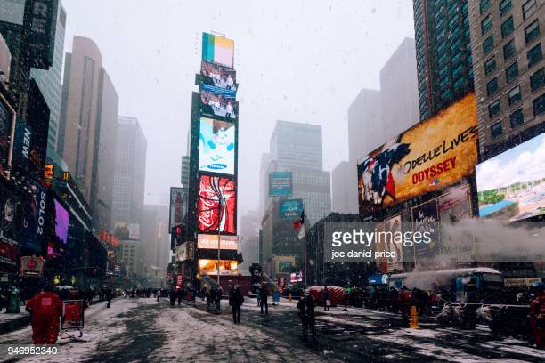 snowy, times square, new york city, new york, america - times square manhattan stock photos and pictures