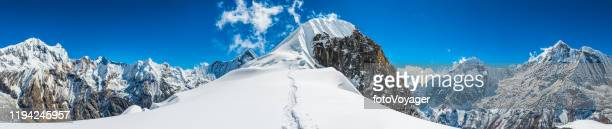 snowy trail to mountain summit panorama annapurna sanctuary himalayas nepal - annapurna south stock pictures, royalty-free photos & images