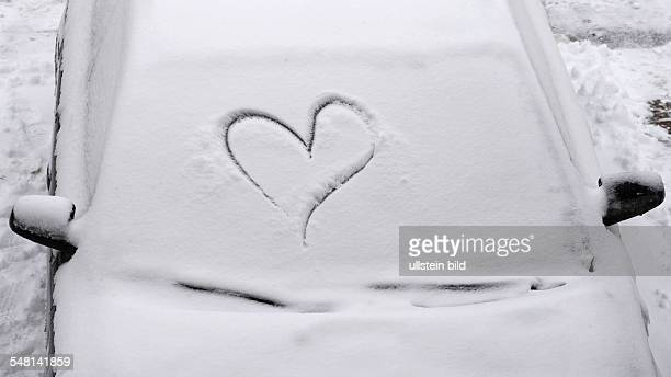 snowy windscreen with a heart