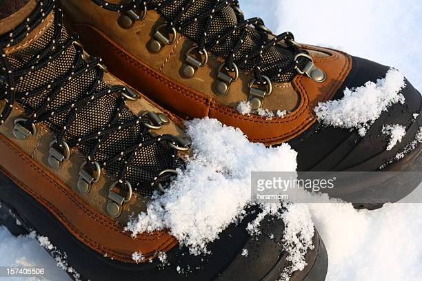 snowy winter boots - snow boot stock photos and pictures