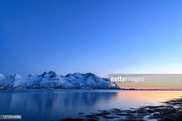 "snowy winter landscape sunset in the lofoten in norway - ""sjoerd van der wal"" or ""sjo"" stock pictures, royalty-free photos & images"