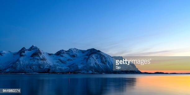 snowy winter landscape sunset in the lofoten in norway - lofoten stock pictures, royalty-free photos & images