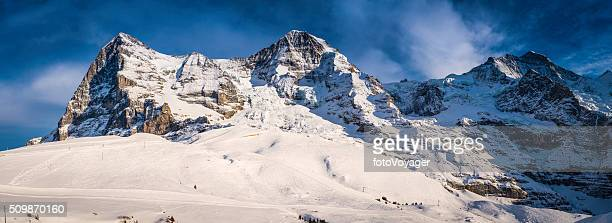 Snowy winter mountain peaks panorama Eiger North Face Alps Switzerland