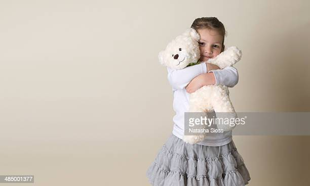 snuggling her bear - teddy bear stock photos and pictures