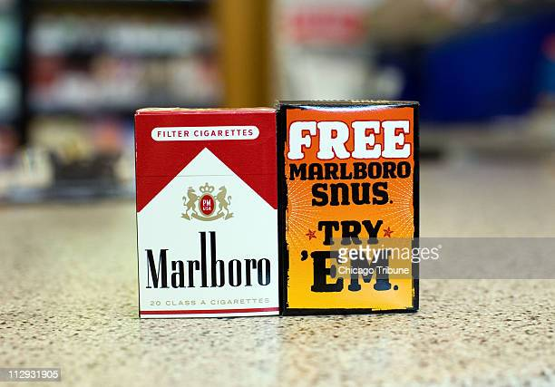Snus a new smokeless tobacco by Philip Morris sold under the Marlboro name is packaged together with Marlboro cigarettes as a free sample at an Exxon...