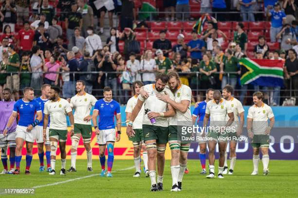 Snyman hugs his team mate Lodewyk de Jager of South Africa following victory in the Rugby World Cup 2019 Group B game between South Africa and...