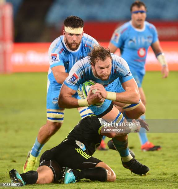 Snyman of the Bulls tackled by TJ Perenara of the Hurricanes during the Super Rugby match between Vodacom Bulls and Hurricanes at Loftus Versfeld...