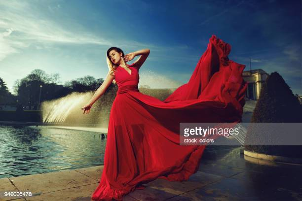 so attractive - red dress stock photos and pictures