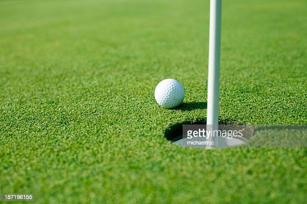 so close! - golf ball stock pictures, royalty-free photos & images