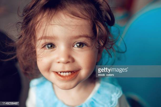 so cute and innocent smile - baby girls stock pictures, royalty-free photos & images