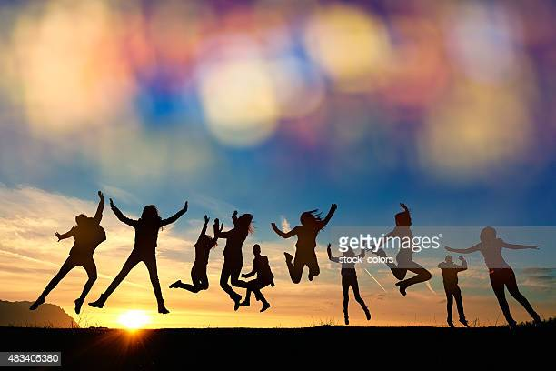 so energic friends jumping at sunset