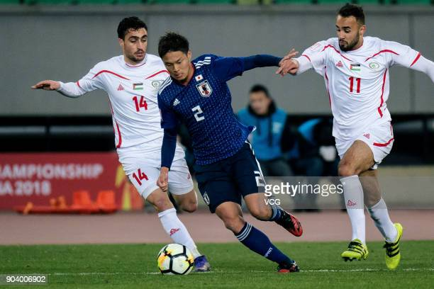 So Fujitani of Japan and Mohamed Darwish of Palestine compete for the ball during the AFC U23 Championship Group B match between Japan and Palestine...