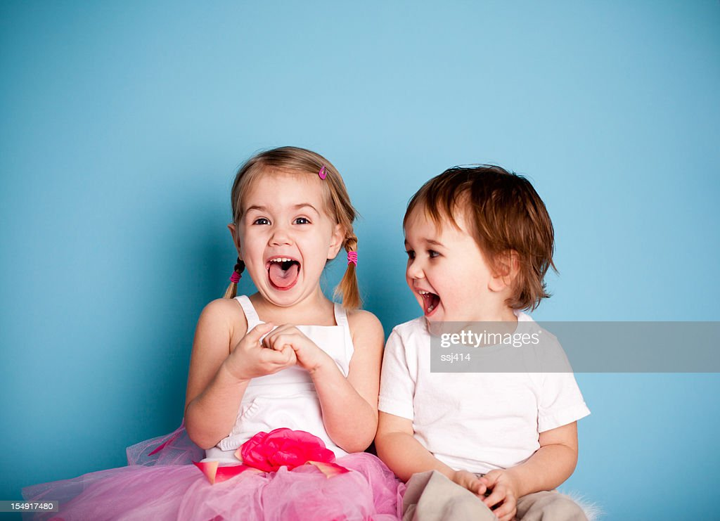 So FUNNY! Girl and Boy Laughing Hysterically : Stock Photo