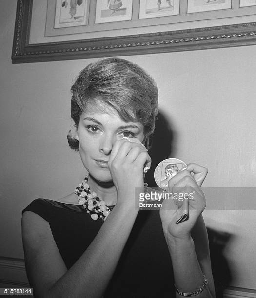 So happy she's crying pretty Perette Pradier displays the Suzanne Bianchetti medal awarded to her as this year's most promising young actress in...