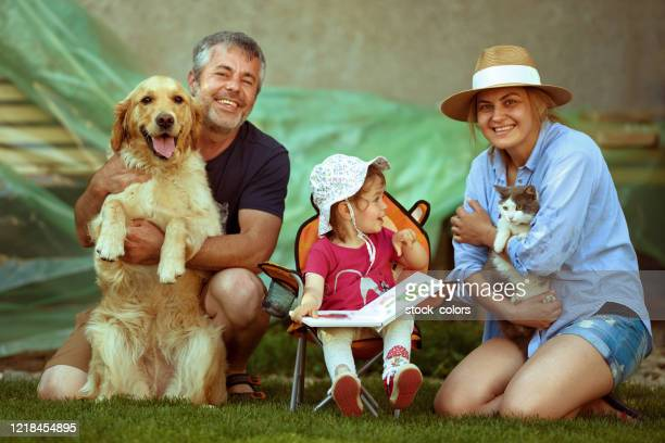 so happy together! family time! - cat with red hat stock pictures, royalty-free photos & images