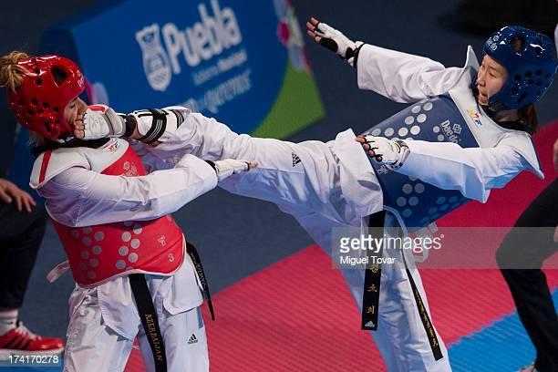 So Hee Kim of Korea competes with Gunay Aghakishiyeva of Azerbaijan during a Women's 57 kg combat of WTF World Taekwondo Championships 2013 at the...