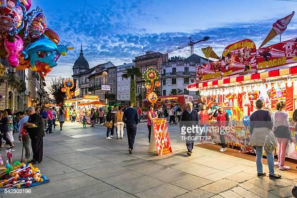 são joão festival and kiosks at city square in braga - braga district stock photos and pictures