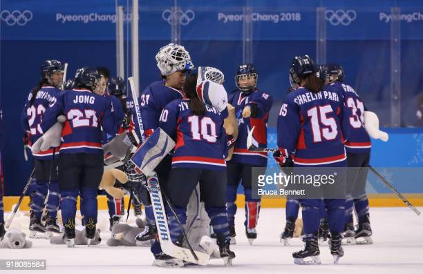 So Jung Shin of Korea and Jiyeon Choi of Korea console each other after their defeat to Japan during the Women's Ice Hockey Preliminary Round Group B...