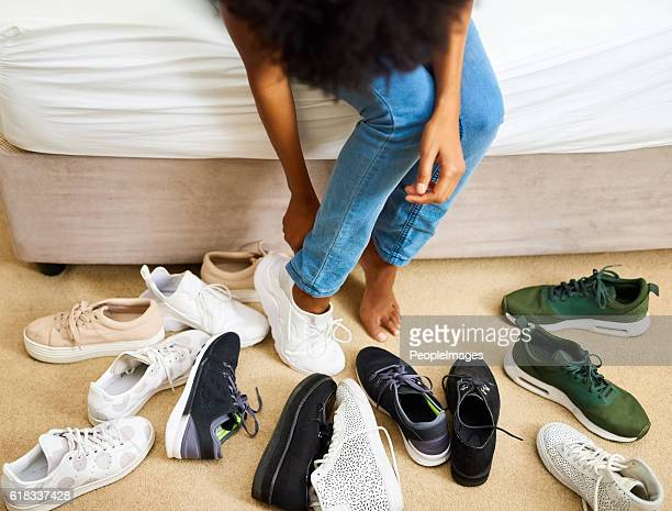 so many shoes, only two feet - black shoe stock pictures, royalty-free photos & images