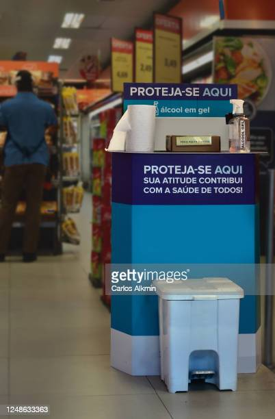 são paulo - signage of protection items to prevent contamination by covid-19 at the entrance to a small supermarket in são paulo, brazil - carlos alkmin stock pictures, royalty-free photos & images