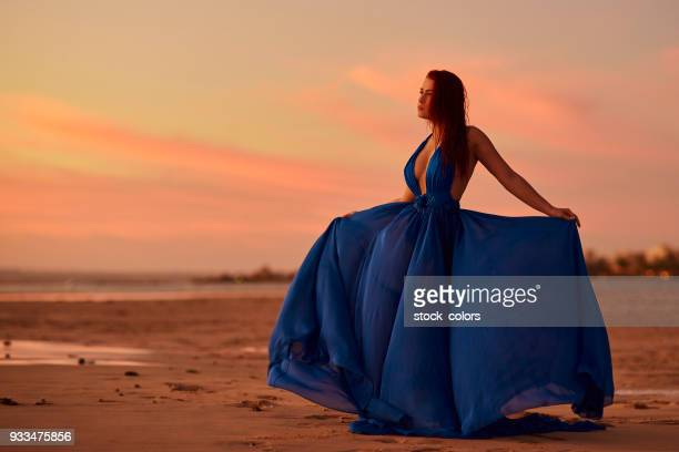 so relaxed in the sunset - blue dress stock pictures, royalty-free photos & images