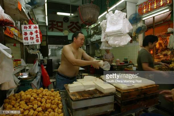 So Sing-fung of Kung Wo Beancurd Restaurant prepares fresh tofu at their shop in Sham Shui Po. 28 July 2005