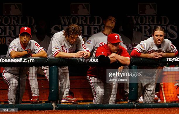 So Taguchi Jayson Werth and Chase Utley of the Philadelphia Phillies look on from the dugout against the Tampa Bay Rays during game two of the 2008...