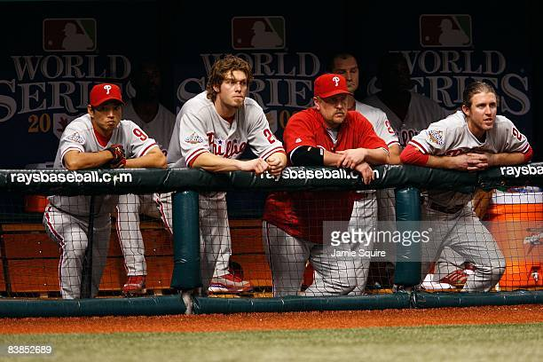 So Taguchi Jayson Werth Matt Stairs and Chase Utley of the Philadelphia Phillies look on from the dugout against the Tampa Bay Rays during game two...