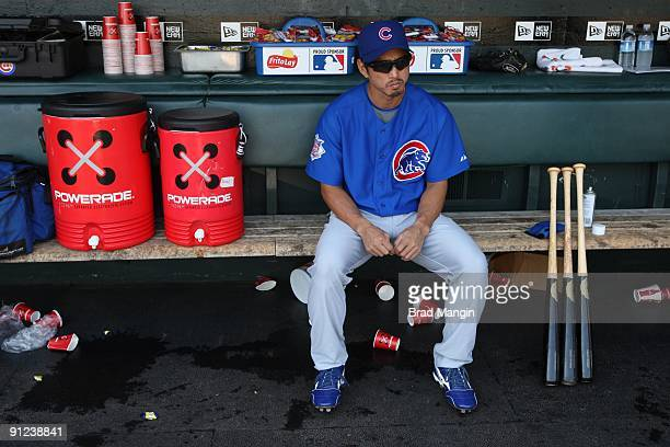 So Taguchi of the Chicago Cubs gets ready in the dugout before the game against the San Francisco Giants at ATT Park on September 27 2009 in San...