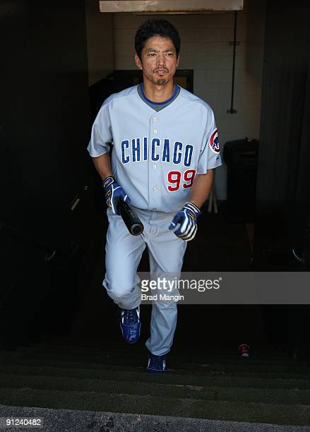 So Taguchi of the Chicago Cubs gets ready in the dugout before the game against the San Francisco Giants at ATT Park on September 26 2009 in San...