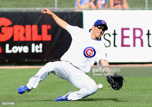 So Taguchi of the Chicago Cubs is unable to make a diving catch on a single hit by the Oakland Athletics in the seventh inning of the spring training...