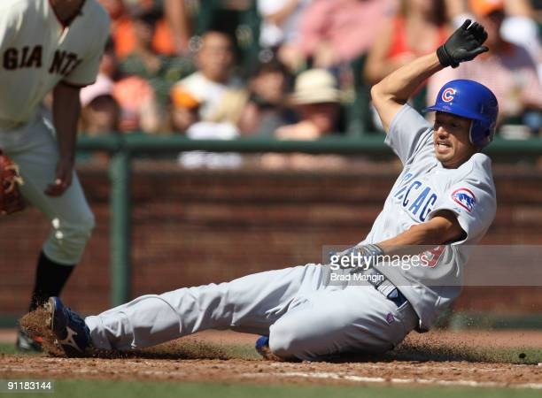 So Taguchi of the Chicago Cubs slides home safely against the San Francisco Giants during the game at ATT Park on September 26 2009 in San Francisco...