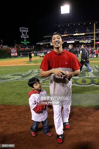 So Taguchi of the Philadelphia Phillies and his 4year old son Kan celebrate on the field after the Phillies won the World Series with their 43 win...