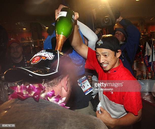 So Taguchi of the Philadelphia Phillies celebrates in the locker room after the Phillies won the World Series with their 43 win against the Tampa Bay...
