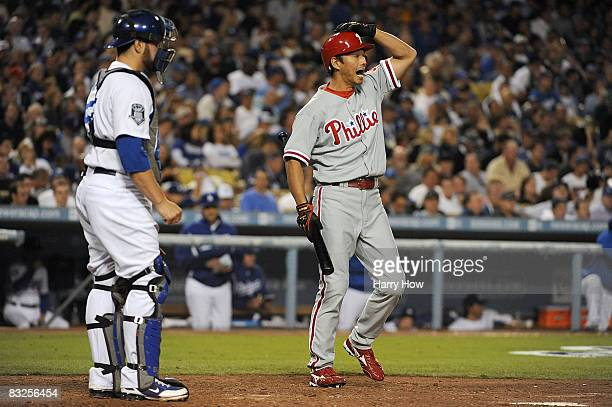 So Taguchi of the Philadelphia Phillies reacts to a pitch as catcher Russell Martin of the Los Angeles Dodgers looks on in Game Four of the National...