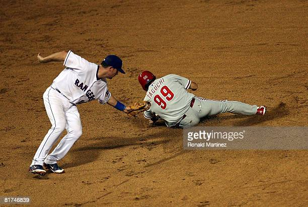 So Taguchi of the Philadelphia Phillies steals second base against Michael Young of the Texas Rangers during Interleague MLB action on June 27 2008...