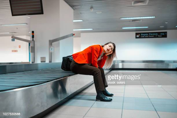 so tired woman in the airport - arrival stock pictures, royalty-free photos & images
