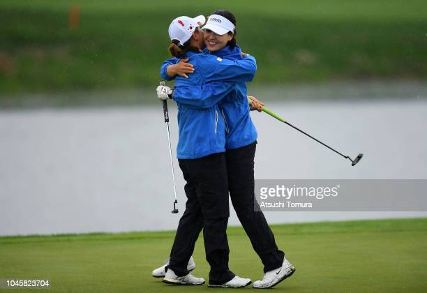 So Yeon Ryu and In Gee Chun of South Korea celebrate their victory on the 17th green in the Pool A match between South Korea and Australia on day two...