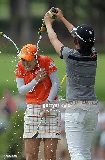 So Yeon Ryu of Korea is doused by champagne by Jinyoung Pak of Korea after Ryu won the U.S. Women's Open in a playoff against Kee Kyung Seo of Korea...